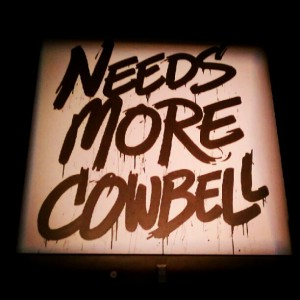 "sign that says ""needs more cowbell"""