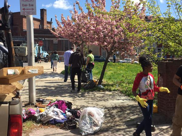 """A different kind of mob is taking to #Baltimore streets, these people armed with brooms, dustpans and good intentions"" via Brian Kuebler/@BrianfromABC2"
