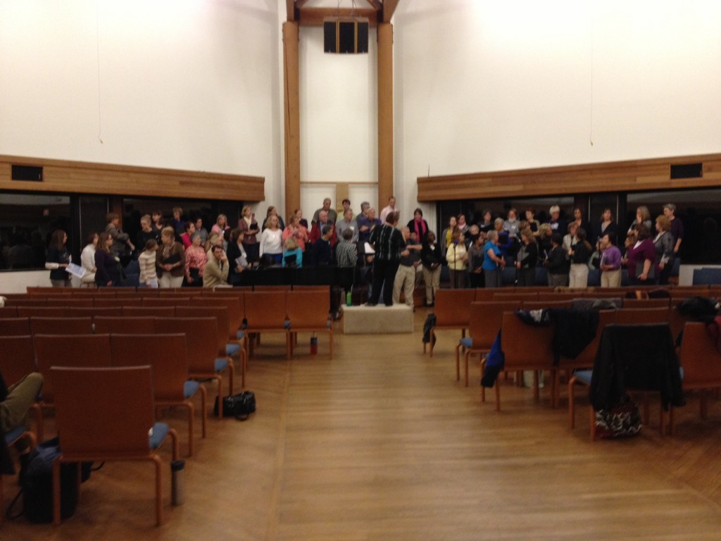 nearly 70 VCS singers standing in formation at uucf during show week rehearsal - we fit, just barely